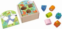 Haba Shape sorting box Animals - Call colors, shapes and animals with their treasure! By the way are beautiful stories about rattle Stork, frog, rabbit, butterfly...